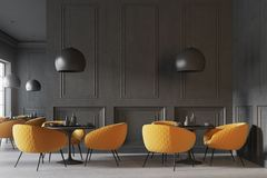 Black cafe interior. With a concrete floor, round black tables and yellow chairs. 3d rendering mock up Stock Photography