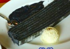 Black cake served with vanilla icecream ball Stock Photography