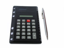 Black calculator. Calculator with silver pen royalty free stock image