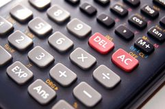 Black calculator. Close up view of numbers and symbol on canculator Stock Images