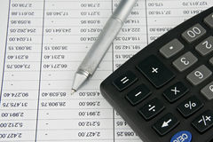 Black calculator and finance account with pen Stock Images