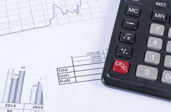 Black calculator on the graphic and the financial statements. Stock Images