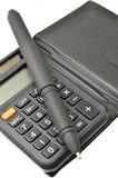 Black calculator with pen Royalty Free Stock Images