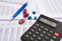 Black calculator, pen, small house Royalty Free Stock Images