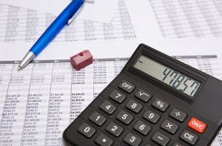Black calculator, pen, small house Royalty Free Stock Image