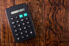 Black Calculator on Wood Desk Stock Images