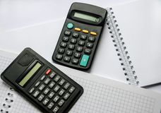 Black calculators isolated on white background stock images