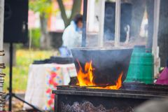 Black caldron for cooking. Is at the stake royalty free stock photo