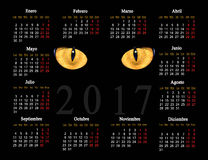 Black calendar for 2017 with cat eyes in Spanish Royalty Free Stock Image