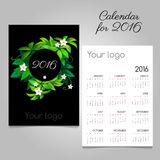 Black calendar 2016 with green floral wreath. Black two-sided calendar 2016 with green floral wreath Royalty Free Stock Photography