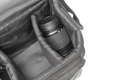 Black camera bag on open, have camera lens white background Royalty Free Stock Photos