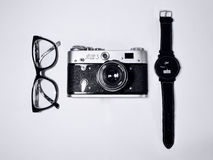 Black Camera Beside Black Eyeglasses and Black Wrist Watch Royalty Free Stock Images
