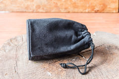 Black camera lens bag on wood Royalty Free Stock Photo
