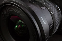 Black camera lens  on black background Stock Images