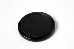 Black Camera Lens Cap. Isolated on white background Royalty Free Stock Photo