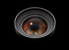Black camera lens with eye Stock Photo