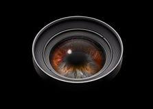Black camera lens with eye Stock Photo