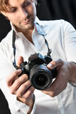 Black camera of man. Black camera in hands of a man Royalty Free Stock Photography
