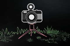 Black camera on tripod drawing by pastel Stock Photography