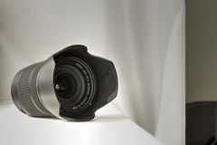 Black camera zoom lens on white cloth Stock Photo