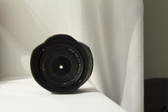 Black camera zoom lens on white cloth Royalty Free Stock Photography