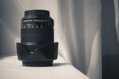 Black camera zoom lens on white cloth Royalty Free Stock Images