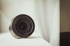 Black camera zoom lens on white cloth Stock Photography