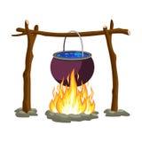 Black camping pot over a bonfire Stock Images