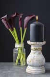 Black candle and black calla flowers Zantedeschia. Decor idea Royalty Free Stock Images