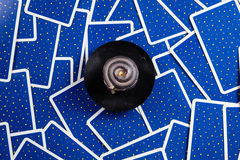 Black candle on a blue tarot cards. Stock Images