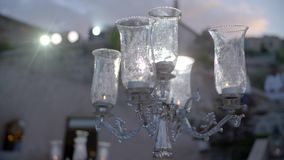 Black Candles on Candlesticks. White candles on glass candlesticks. Home decoration in slow motion stock video footage