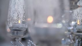 Black Candles on Candlesticks. White candles on glass candlesticks. Home decoration in slow motion stock video