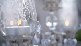 Black Candles on Candlesticks. White candles on glass candlesticks. Home decoration in slow motion stock footage