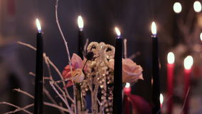 Black candles on the dinner table stock footage