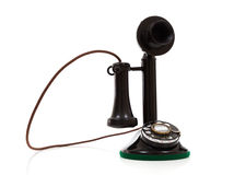 A black candlestick phone on a white background Stock Photo