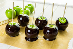 Black candy apples Stock Images