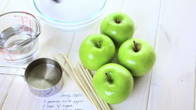 Black candy apples. Ingredients for preparing homemade black candy apples stock video footage