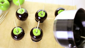 Black candy apples. Ingredients for preparing homemade black candy apples stock footage