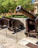 Black cannon at the Alhambra palace in Granada, Spain, Europe. On a bright warm summer day Royalty Free Stock Photo