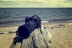 Black Canon Dslr Camera Near Sea Shore stock images