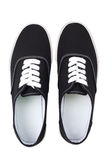 Black canvas sneakers, Top view Stock Images