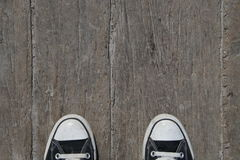 Black canvas sneakers on wood Royalty Free Stock Photo