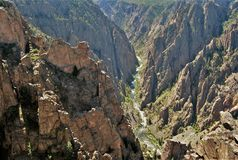 Black Canyon Chasm. Black Canyon of the Gunnison in Crawford, Colorado has some of the steepest cliffs, craggiest spires and oldest rock in North America Royalty Free Stock Images