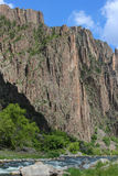 Black Canyon of the Gunnison. A breathtaking view of the sheer steep cliff walls of the Black Canyon of the Gunnison National Park gorge Royalty Free Stock Images