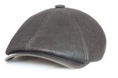 Black cap. Black leather cap on a white background Stock Image
