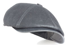 Black cap. Black leather cap on a white background Royalty Free Stock Photos