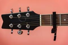 Black capo on a guitar Stock Image