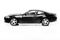 Black car. Beautiful shot of black car over white background Stock Photography