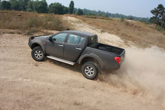 Black car 4wd on the road. Black 4wd car go to the dust road Stock Photo