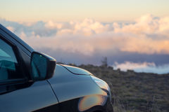 Black car above the clouds at sunset or sunrise Stock Photography